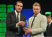 22 March 2015; Republic of Ireland International Sam Byrne, winner of the Republic of Ireland U19 player of the year award, is presented with his award by Republic of Ireland International John O'Shea at the 3 FAI International Football Awards. RTE Studios, Donnybrook, Dublin. Picture credit: David Maher / SPORTSFILE