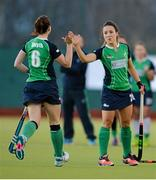 22 March 2015; Emma Smyth, Ireland, is congratulated by Anna O'Flanagan, right, after scoring during the penalty shoot out. Ireland v Canada - World Hockey League 2 Final, National Hockey Stadium, UCD, Belfield, Dublin. Picture credit: Brendan Moran / SPORTSFILE