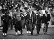 16 October 1991; Republic of Ireland's Mick McCarthy speaks to manager Jack Charlton as they leave the pitch after the game. UEFA Euro 1992 qualifying Group 7 match, Poland v Republic of Ireland, Stadion Miejski, Poznan, Poland. Picture credit: Ray McManus / SPORTSFILE