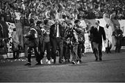 16 October 1991; Republic of Ireland manager Jack Charlton leaves the pitch after the game surrounded by substitutes and backroom staff. UEFA Euro 1992 qualifying Group 7 match, Poland v Republic of Ireland, Stadion Miejski, Poznan, Poland. Picture credit: Ray McManus / SPORTSFILE