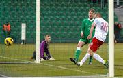 26 March 2015; Caoimhin Kelleher, left, and Jonathon Lunney, centre, Republic of Ireland, react as Pawel Kaczmarczyk, Poland, scores a goal. UEFA U17 Championships Elite Phase, Group 4, Republic of Ireland v Poland. Stadium Groclin Dyskobolia, Grodzisk Wielkopolski, Poland. Picture credit: Jakub Piasecki / SPORTSFILE