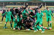 26 March 2015; The Republic of Ireland players celebrate at the end of the game, after qualifying for the UEFA U17 Championships. UEFA U17 Championships Elite Phase, Group 4, Republic of Ireland v Poland. Stadium Groclin Dyskobolia, Grodzisk Wielkopolski, Poland. Picture credit: Jakub Piasecki / SPORTSFILE