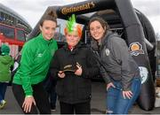29 March 2015; Continental Tyres women's national league and Irish women's national team and UCD Waves players Sarah Cluine and Karen Duggan were at the Aviva Stadium for the Republic of Ireland v Poland game today. The two Irish Internationals challenged fans going to the match to a penalty shoot out compeititon outside the stadium in association with Continental Tyres, proud supporters of Irish womens soccer and official partner of the FAI. Pictured are Andrew Walsh, aged twelve, from Kildare, with UCD Waves players Sarah Cluine, right, and Karen Duggan.  For more infortmation on Continental Tyres visit www.continental-tyres.com. Aviva Stadium, Lansdowne Road, Dublin. Picture credit: Pat Murphy / SPORTSFILE