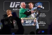 31 March 2015; UFC featherweight Conor McGregor, right, is restrained by UFC President Dana White after grabbing the title belt from UFC featherweight Champion Jose Aldo during a fan event. The Convention Centre Dublin, Spencer Dock, North Wall Quay, Dublin. Picture credit: Ramsey Cardy / SPORTSFILE