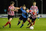1 April 2015; Daire O'Conchubhair, UCD, in action against Jack Blake, left, and Aidan McCauley, Derry City. SSE Airtricity U19 League Enda McGuill Cup Final, UCD v Derry City. The UCD Bowl, UCD, Belfield, Dublin. Picture credit: Piaras Ó Mídheach / SPORTSFILE