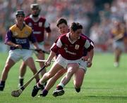 Galway's Brian Higgins in action against Wexford in the 1996 All-Ireland U-21 Hurling Final in Thurles.  Photograph: David Maher SPORTSFILE.