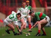 All-Ireland Club Hurling Final, Birr v Sarsfields, Croke Park. 17/3/98. Action features Birr's Brian Whelahan in action against Sarsfields Peter Kelly. Photograph © Brendan Moran SPORTSFILE.