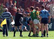 Dublin's Charlie Redmond and Meath's Darren Fay get involved in a heated exchange during the   Leinster C'ship clash at Croke Park. 15/6/97. Photograph: David Maher SPORTSFILE.