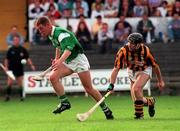 Limerick's Ciaran Carey gets away from Kilkenny's D.J. Carey during the National Hurling League semi-final in Nowlan Park. 28/8/97. Photograph David Maher SPORTSFILE.