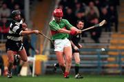 Birr's Conor Hanniffy gets his shot in despite the attentions of Clarecastle's Kenneth Morrissey during the All-Ireland Club Hurling semi-final at Semple Stadium, Thurles. 15/2/98. Photograph: Ray McManus SPORTSFILE.