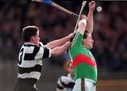 All-Ireland Club Hurling semi-final replay, Thurles 28/2/98. Birr v Clarecastle. Action features Daith' Regan, Birr, right, in a tussle for possession with Martin Sheedy, Clarecastle. Photograph © Ray McManus SPORTSFILE.