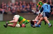 National Football League, Section C, Dublin v Kerry, Parnell Park. 15/3/98. Kerry's Dara O'Cinneide, left, lands on his head after a race for possession with  Dublin's Paddy Christie with Keith Galvin ( Dublin no 7 ) in support.  Photograph ©ÊBrendan Moran SPORTSFILE.