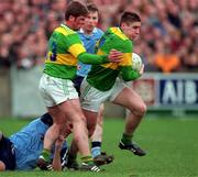 National Football League, Section C, Dublin v Kerry, Parnell Park. 15/3/98. Kerry's Darragh O'Sé, with support from Dara O'Cinneide, comes away from the challenge of Dublin's Ciaran Whelan.  Photograph ©Brendan Moran SPORTSFILE.