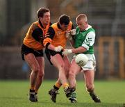 Declan Darcy Leinster clashes with Ulster players Gary Coleman and Kieran McGeeney, left. 8/2/98. Photograph: Ray McManus SPORTSFILE.