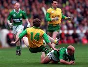 All-Ireland Club Football Final, Corofin v Erin's Isle, Croke Park. 17/3/98. Corofin's Eddie Steede takes a tumble over the back of Erin's Isle Keith Murray. Photograph © David Maher SPORTSFILE.