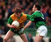 All-Ireland Club Football Final, Corofin v Erin's Isle, Croke Park. 17/3/98. Corofin's Eddie Steede holds off the challenge of Erin's Isle's Ken Spratt. Photograph © Brendan Moran SPORTSFILE.
