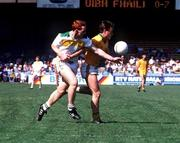 James Stewart, Offaly, left, in action against Bernard Flynn, Meath, during the 1988 Leinster Football semi-final at Croke Park. 2/7/89. Photograph © SPORTSFILE.