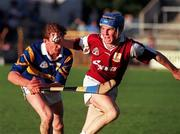 Galway's Kevin Broderick holds off the challenge of Tipperary's George Frend during the National Hurling League semi-final in Thurles. 28/8/97. Photograph SPORTSFILE.
