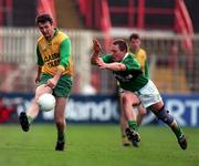 All-Ireland Club Football Final. Corofin v Erin's Isle, Croke Park. 17/3/98. Corofin's Gerry Burke gets in his shot despite the challenge of Erin's Isle's Johnny Barr. Photograph  Brendan Moran SPORTSFILE.