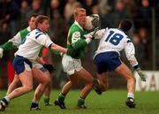 Leinster's Graham Geraghty holds off the challenge of Connacht's Damien Mitchell, left, and Noel Connelly (18).  Railway Cup Final . 8/2/97. Photograph: Ray McManus SPORTSFILE.