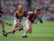 Galway's Gregory Kennedy in action against Wexford in the 1996 All-Ireland   U-21 Hurling Final in Thurles.  Photograph: David Maher SPORTSFILE.