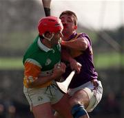 Hubert Rigney Offaly in action against Martin Storey Wexford, Birr 23/3/97.  Photograph David Maher SPORTSFILE