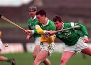 Church & General National Hurling League Offaly v Limerick 8/3/1998 Action Features Offaly's Killian Farrell and Limerick's Mike Houlihan Photograph Matt Browne SPORTSFILE