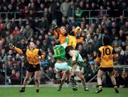 Ulster's Jarlath Burns wins possession from teammate Kieran McGeeney and Leinster pair Brian Stynes and John McDermott (hidden). The two Ulster players awating developments are Henry Doewney, left and Jim McGuinness (10) Photograph Ray McManus SPORTSFILE 8/2/98