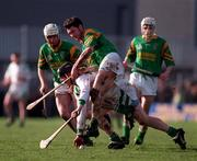 Joe Cooney Sarsfields in action against Frankie McMullan Dunloy, Club Hurling Semi Final, 1/3/98. Photograph Ray McManus © SPORTSFILE