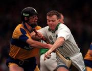 Clare V Limerick, National Hurling League, Gaelic Grounds, 23/3/98, Joe Quaid Limerick in action against Niall Gilligan Clare. Photograph © Matt Browne SPORTSFILE.