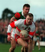 National Football League Quarter Final, Down v Monaghan, Croke Park, 5/4/98. Johnny McBride, Derry in action against Mayo's Colm McManaman. Photograph ©ÊDamien Eagers SPORTSFILE.