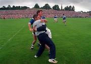 Cavan manager Martin McHugh and Ciaran Brady celebrate their side's victory over Derry in the Ulster Football Final in Clones. 20/7/97.  Photograph David Maher SPORTSFILE