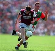 Michael Donnelan Galway races away from Colm McMenamon Mayo, Tuam, 25/5/97). Photograph Ray McManus SPORTSFILE.