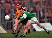 Ulster's Mickey Linden gets his shot in despite the blockdown attempt by Leinster's Dermot Brady.   Railway Cup semi-final. 26/1/97. Photograph: Ray McManus SPORTSFILE.