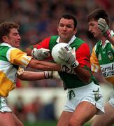 Mayo'sw Liam McHale is tackled by Offaly's Tom Coffey, left, and Larry Carroll during the All-Ireland Football semi-final at Croke Park. Photograph: Matt Browne SPORTSFILE.