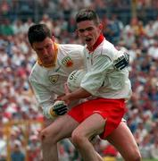 Tyrone's Mark Harte holds off the challenge of Antrim's John Finucane during the Ulster Minor Football Final in Clones. 20/7/97. Photograph: David Maher SPORTSFILE.
