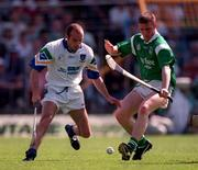 Limerick's James Moran in a tussle for possession with Waterford's Mark O'Sullivan at Semple Stadium.   25/5/97. Photograph: Brendan Moran SPORTSFILE.