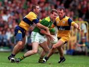 Kerry's Mike Hassett is put under pressure by Clare's Barry Keating, left, and Martin Daly during the Munster Football Final. 20/7/97. Photograph: Matt Browne SPORTSFILE.