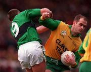 All-Ireland Club Football Final, Erin's Isle v Corofin, Croke Park. 17/3/98. Corofin's Ray Silke holds off the challenge of Erin's Isle's Johnny Barr. Photograph © David Maher SPORTSFILE.