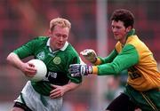 All-Ireland Club Football Final. Corofin v Erin's Isle, Croke Park. 17/3/98. Erin's Isle's Robbie Boyle gets away from Corofin's Jason Killeen. Photograph  Brendan Moran SPORTSFILE.