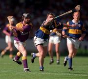 17 August 1997; Sean Flood, Wexford and Liam McGrath, Tipperary. Tipperary v Wexford, All-Ireland Hurling semi-final. 17/8/97. Photograph: Matt Browne SPORTSFILE.