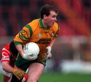 National Football League Quarter Final, Cork v Donegal, Croke Park, 5/4/98. Donegal's Tony Boyle in action against Cork. Photograph © Ray McManus SPORTSFILE.
