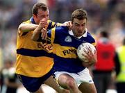 25 June 2000; Damien Byrne of Tipperary in action against Martin Daly of Clare during the Bank of Ireland Munster Senior Football Championship Semi-Final match between Clare and Tipperary at the Gaelic Grounds in Limerick. Photo by Brendan Moran/Sportsfile