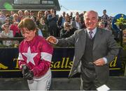 6 April 2015; Jockey Katie Walsh celebrates with her father and trainer Ted Walsh after her mount Thunder And Roses won the BoyleSports Irish Grand National Steeplechase. Fairyhouse Easter Festival, Fairyhouse, Co. Meath. Picture credit: Pat Murphy / SPORTSFILE