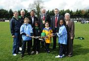 24 April 2008; Attending the 'Cuman Caman Lets Stick Together' social inclusion blitz day were, back row, from left, Sinead O'Connor, Sponsorship and Finance Manager, Liam Ryan, Lucan Sarsfields, Tony Watene, GAA, Deputy Lord Mayor of Dublin Derek Keating, Kieran Leddy, GAA, and Síle De Bhailis, Ardstiúrthóir, Cumann Camógaíochta na nGael. Front row, from left, Eve Tuohy, age 9, attending Scoil Mhuire Girls National School, Miass Jassim, age 9, originally from Iraq and currently attending Scoil Aine, Alanah Ní Bhreacain, age 9, attending Gaelscoil Naomh Phadraig, and Kimberly Chiala, age 9, originally from Zambia and currently attending Scoil Mhuire Girls National School. Cumann Camogaiochta na nGael. Children from twenty-seven different countries joined with Irish children from eight primary schools in Lucan for a day of fun and camogie. Lucan Sarsfields GAA Club, Lucan, Dublin. Picture credit: Stephen McCarthy / SPORTSFILE