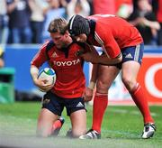27 April 2008; Ronan O'Gara, Munster, is congratulated by team-mate Denis Leamy after scoring his side's first try against Saracens. Heineken Cup Semi-Final, Saracens v Munster, Ricoh Arena, Coventry, England. Picture credit: Brendan Moran / SPORTSFILE *** Local Caption ***
