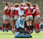 12 April 2015; Loreto goalkeeper Ruth Murphy drops to her knees as the Pegasus players celebrate after the game. Irish Hockey League 2015, Women's Final, Pegasus v Loreto, Grange Road, Rathfarnham, Dublin. Picture credit: Matt Browne / SPORTSFILE