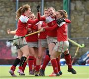 12 April 2015; Pegasus players celebrate with winning penalty scorer Robyn Chambers, 8. Irish Hockey League 2015, Women's Final, Pegasus v Loreto, Grange Road, Rathfarnham, Dublin. Picture credit: Matt Browne / SPORTSFILE