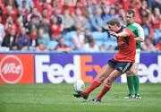 27 April 2008; Munster out-half Ronan O'Gara kicks a conversion watched by referee Nigel Owens. Heineken Cup Semi-Final, Saracens v Munster, Ricoh Arena, Coventry, England. Picture credit: Brendan Moran / SPORTSFILE *** Local Caption ***