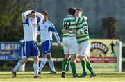 18 April 2015; Sheriff YC captain Paul Murphy, right, and John Rock celebrate at the final whistle as Clonmel Celtic's David Joyce shows his disappointment.  FAI Aviva Junior Cup Semi-Final, Clonmel Celtic v Sheriff YC. Cooke Park, Tipperary Town, Co. Tipperary. Picture credit: Diarmuid Greene / SPORTSFILE